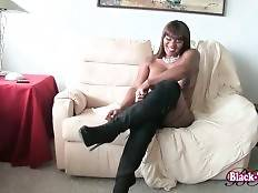 Hot shaped ebony she-male Foxy London is stripping for your joy.