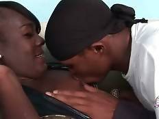 Pretty black tranny and her friend are fondling each other.