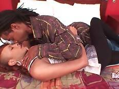 Skinny ebony t-girl Chyna and her friend Cane are kissing on bed.